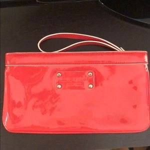 Kate Spade clutch/wristlet - coral in color